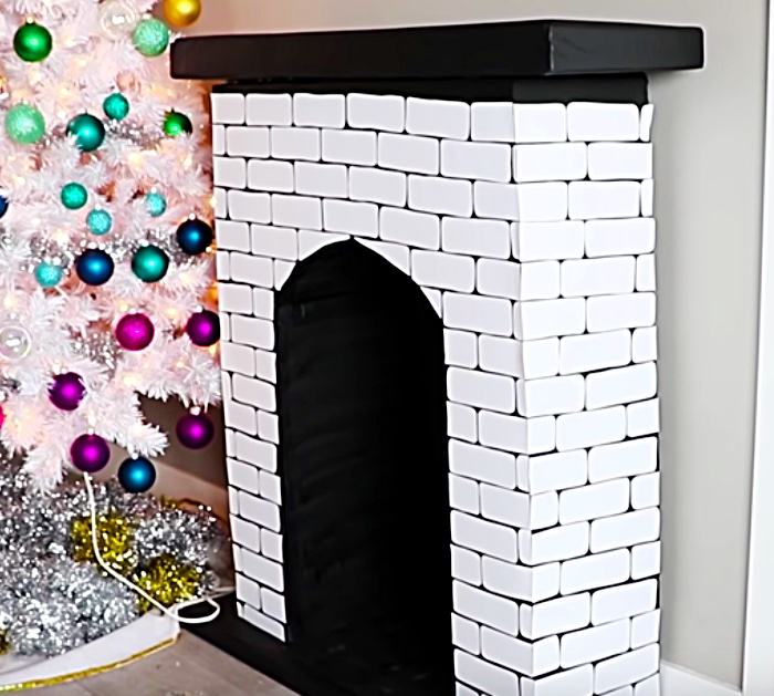 Try this DIY Faux Fireplace out an old cardboard box.