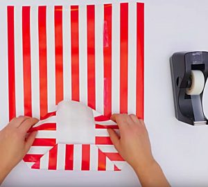 Learn to make a cheap gift bag out of wrapping paper