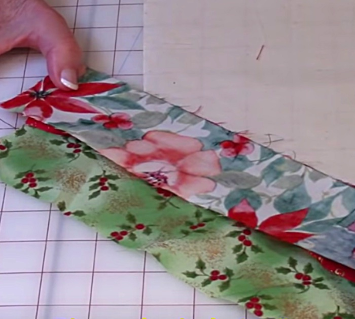 Learn this simple quilted table runner placemat DIY out of a jellyroll or scrap fabrics