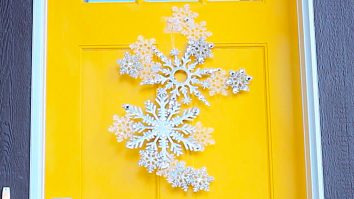 Learn to make this DIY Dollar Store Snowflake Door Hanging