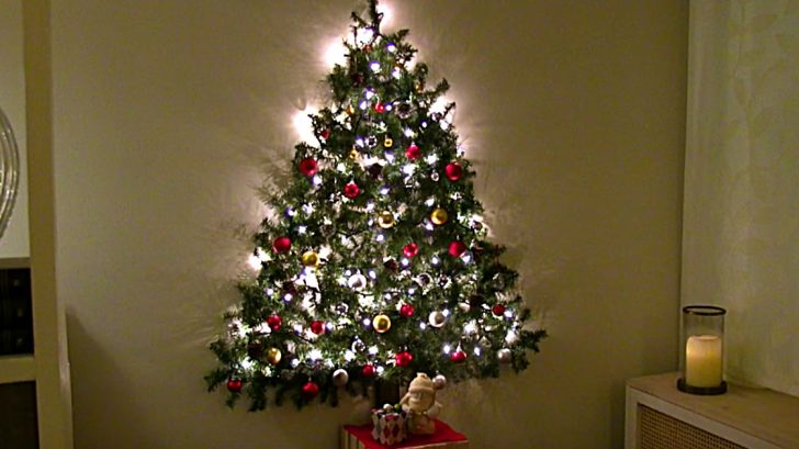 Learn to make this DIY Wall Hanging Christmas Tree for a small apartment