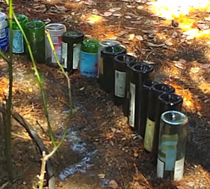 Make a DIY Edging for a Flower Bed Edging out of recycled upcycled wine bottles