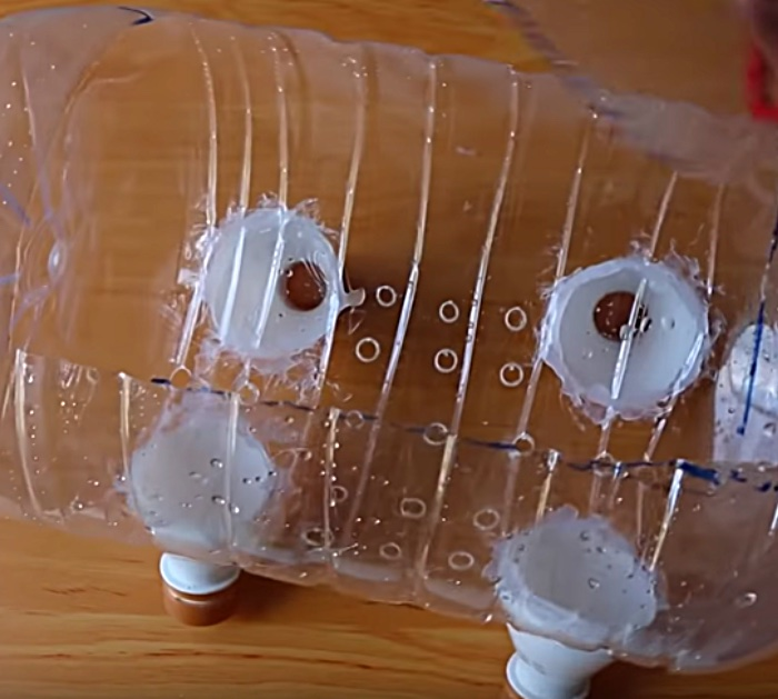 Learn to make a DIY Piggy Planter using recycled upcycled plastic water bottles