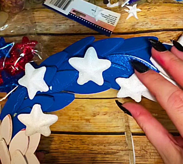 Glue Stars Onto A Patriotic American Flag Wreath