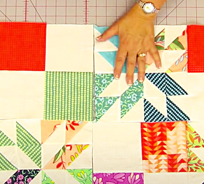 Place Quilt Blocks Together To Make A Hunter's Star Quilt With Jenny Doan