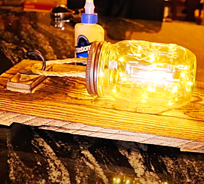 Stuff Battery-Operated Fairy Lights Inside a Mason Jar To make a Rustic Luminary