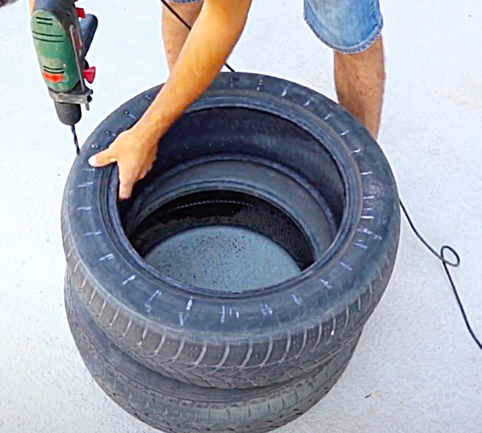 Drill Holes In An Old Tire To Make a DIY Tire Seat